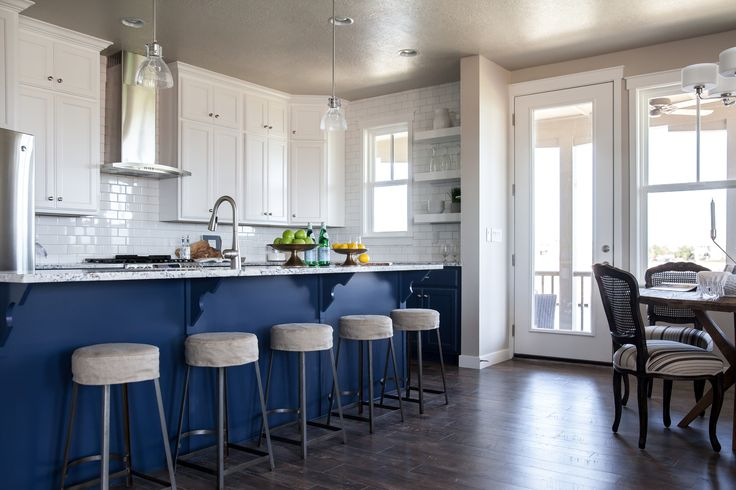 Blue kitchen island with blue and grey granite countertops for Grey blue white kitchen