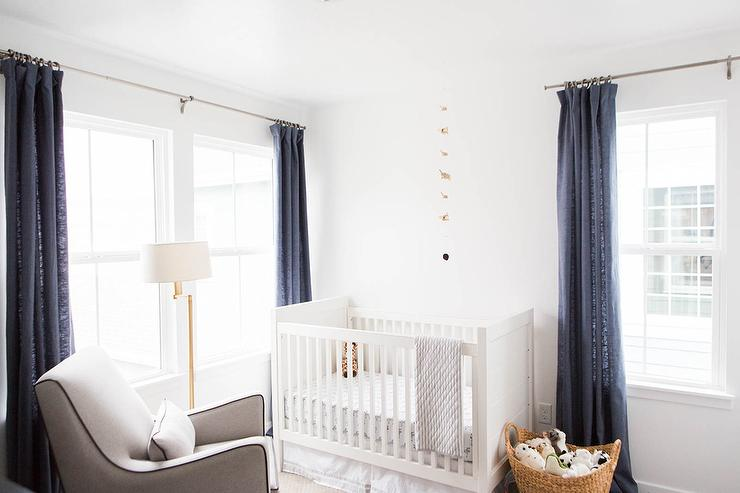 nursery with blue linen curtains transitional nursery