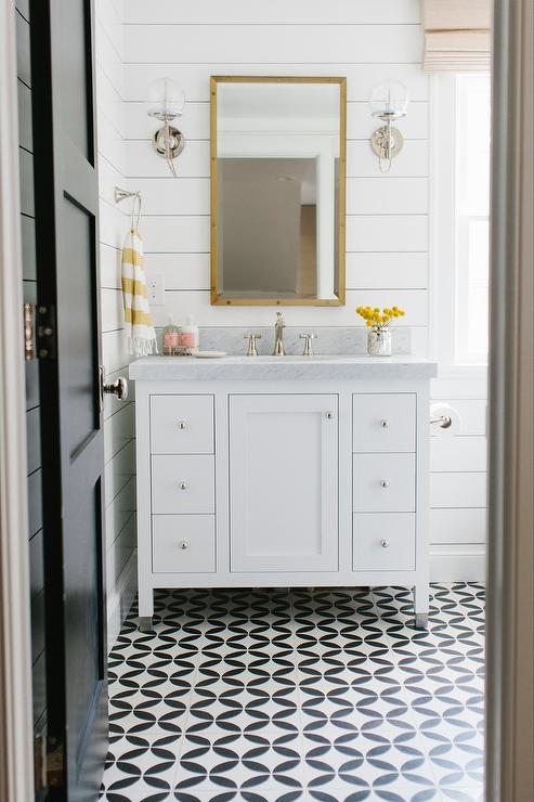 White bathroom with yellow accents transitional bathroom for Black and white tile floors