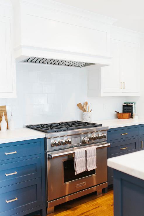 White And Navy Blue Kitchen Features White Upper Cabinets And Navy Lower Cabinets Painted Benjamin Moore Hale Navy Paired With Calacatta Marble Countertops