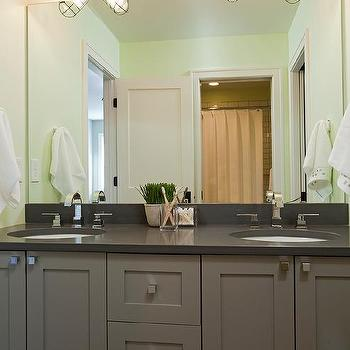 Gray Kids Bathroom Vanity With Green Nautical Cage Sconces
