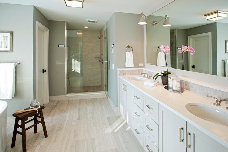 White master bathroom with gray concrete tile floor for Grey wood floor bathroom