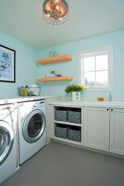 Turquoise Laundry Room with Gray Penny Tiled Floors