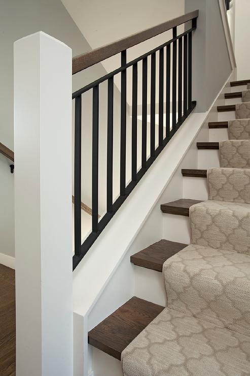 Beautiful Wood And Iron Staircase With A Gray Moroccan Stair Runner
