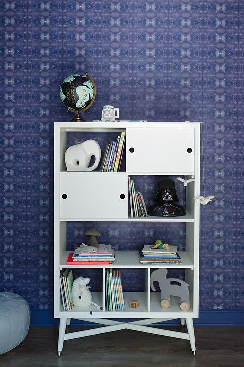 Fantastic Nursery Features A Wall Clad In Eskayel Kaya Wallpaper Lined With Dwell Studio Mid Century French White Bookcase