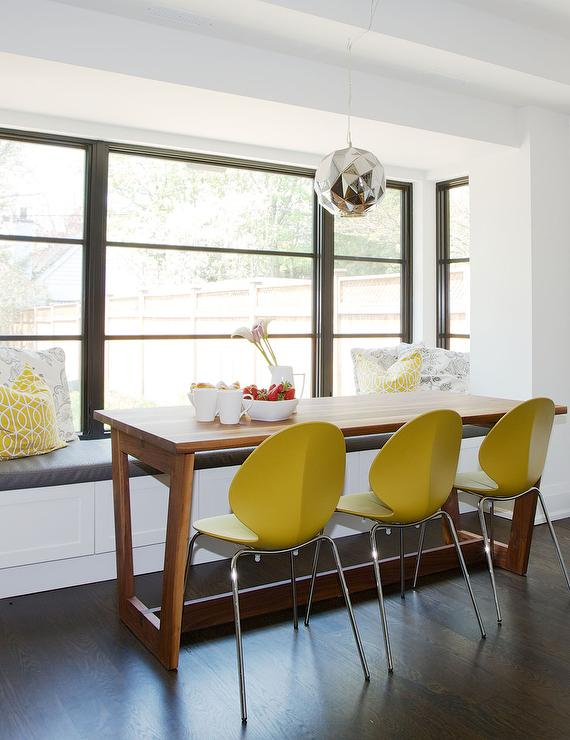 modern wood dining table with yellow dining chairs breakfast table lighting