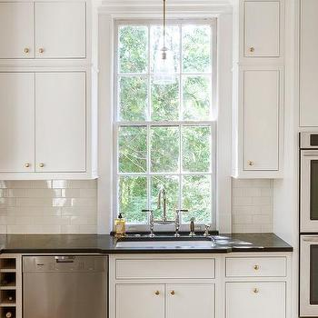 Knobs For White Kitchen Cabinets white kitchen cabinets with brass hardware and black countertops