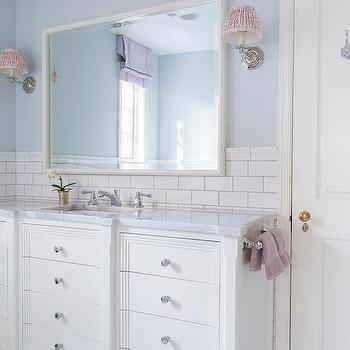 white and blue kids bathroom with lilac accents