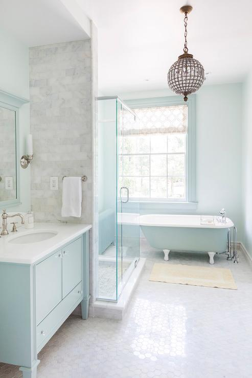Turquoise blue bathroom features walls painted turquoise for Bathroom ideas aqua