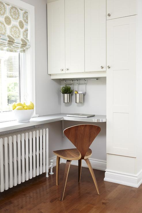 Charming Small Kitchen Desk Part - 6: Fantastic Kitchen Features White Cabinets By Ikea Adorned With Stain Nickel  Knobs Surrounding A Built-in Curved Desk Paired With A Cherner Chair.