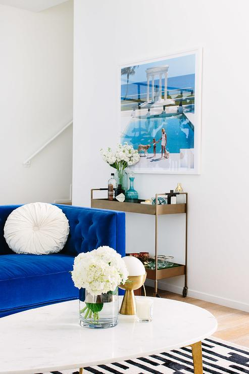 Gorgeous Living Room Features A Cobalt Blue Velvet Tufted Sofa Adorned With  White Pinwheel Pillows Facing An Oval Brass And Marble Cocktail Table Atop A  ... Part 77
