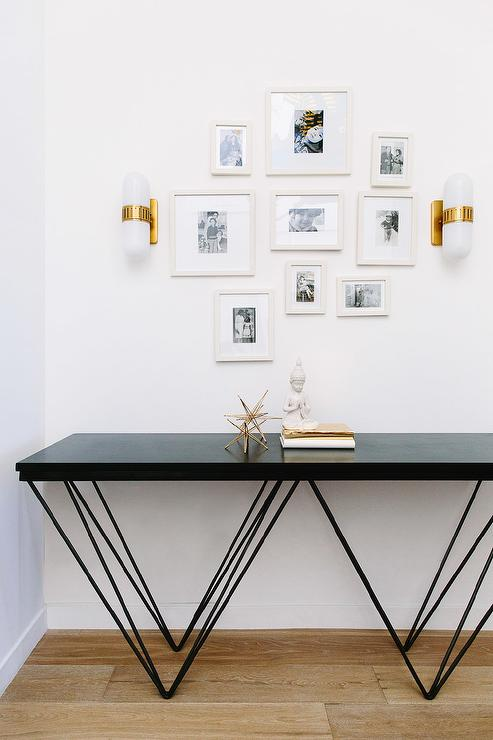 geometric console table and jonathan adler pill capsule wall sconces