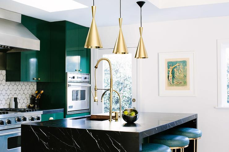 Beautiful kitchen features emerald green flat front cabinets adorned