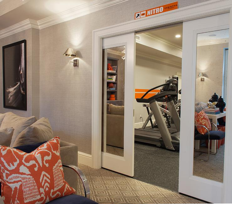 Ordinaire Basement Exercise Room With Mirrored Pocket Doors