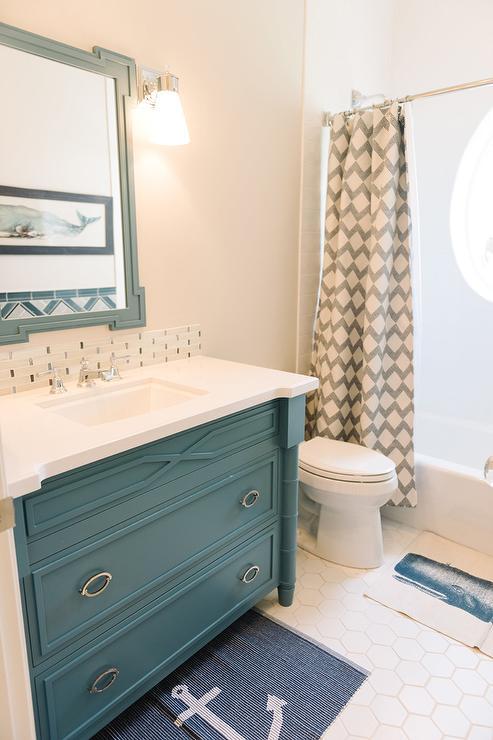blue kids bathroom vanity with blue mirror - cottage - bathroom