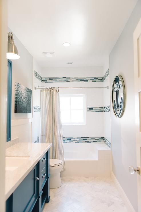 Modern cottage kid s bathroom boasts walls painted pale grey  Sherwin  Williams Gray Screen  lined with a washstand painted blue  Sherwin Williams  Georgian. Gray And Blue Bathroom Design Ideas