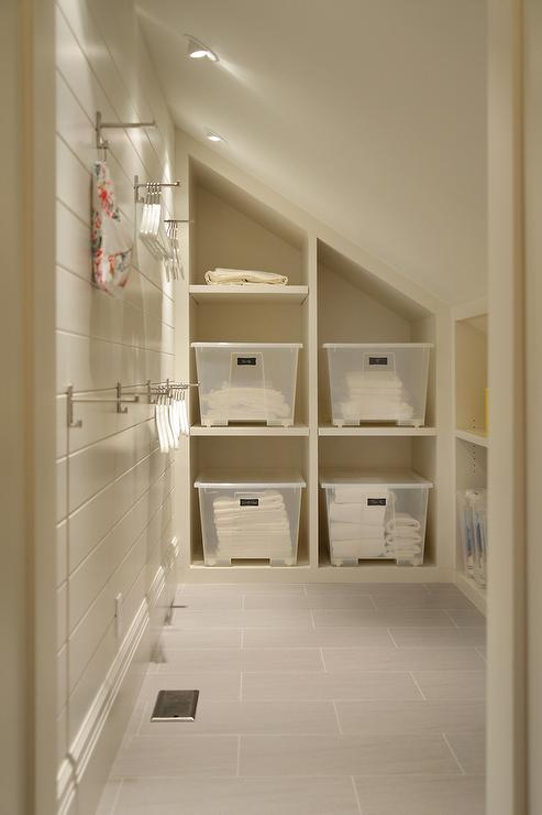 Laundry Room With Sloped Ceiling And Built In Cubbies