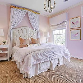 Pink Girls Room With Curtains Behind Headboard