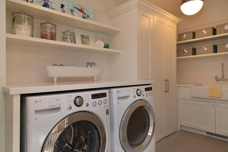 stacked floating shelving over washer and dryer cottage. Black Bedroom Furniture Sets. Home Design Ideas