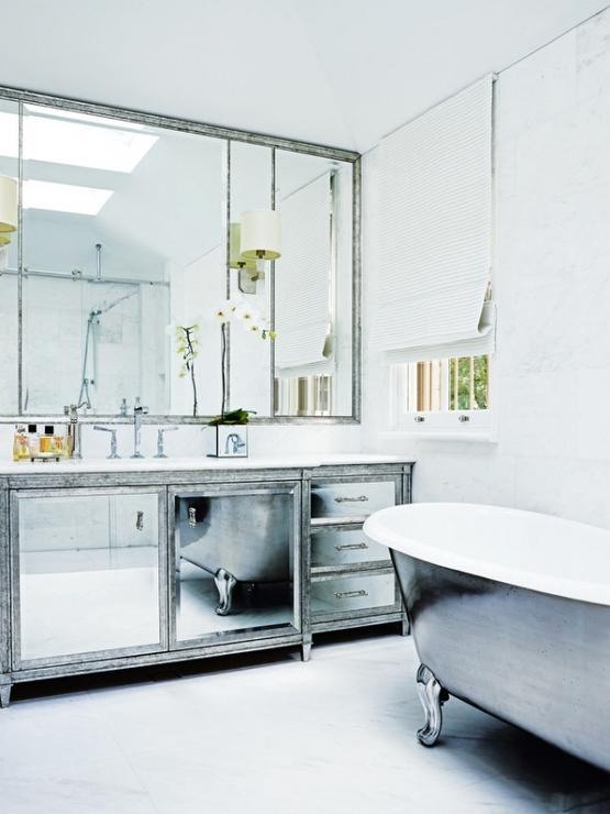 antiqued mirrored bathroom vanity with white marble top