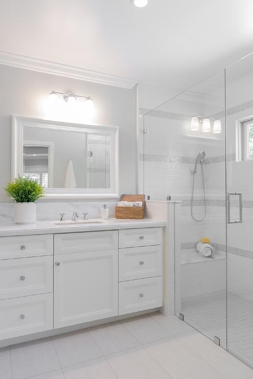 White Subway Tiles With Gray Border Tiles Transitional Bathroom