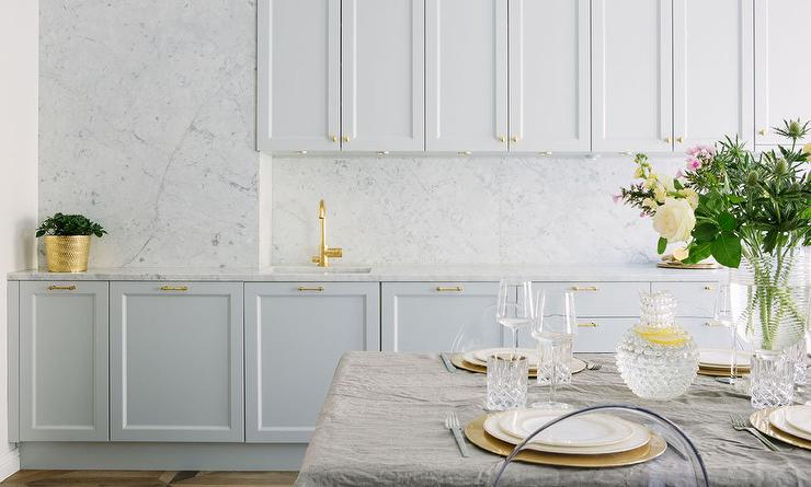 White Kitchen Cabinets With Brass Hardware And Marble