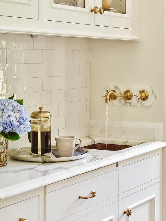 Pantry with Hammered Copper Sink and Wall Mount Gold Spigot Faucet