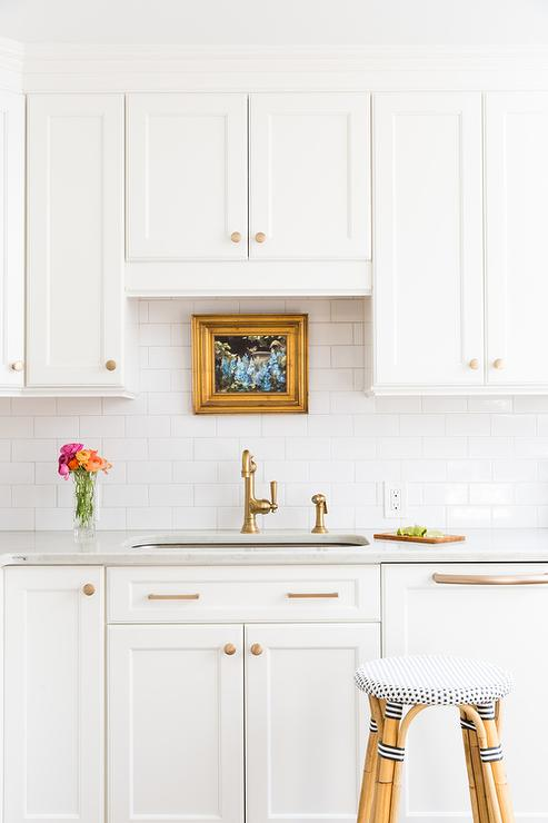 white shaker kitchen cabinets with gold hardware - transitional