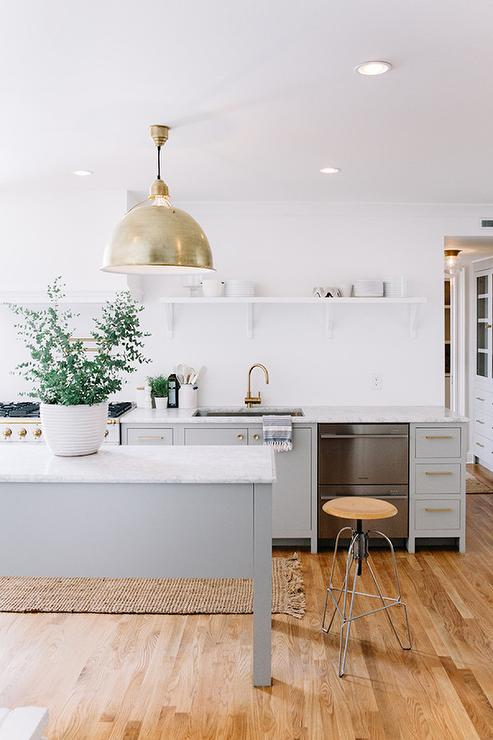 White and Grey Kitchen with God Accents Transitional