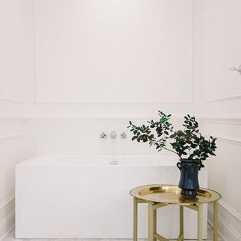 white bathroom with freestanding rectangular tub