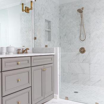 'White Porcelain Marble Like Bathroom Tiles' from the web at 'https://cdn.decorpad.com/photos/2015/09/05/m_white-porcelain-look-like-marble-countertop-single-square-tube-wall-light.jpg'