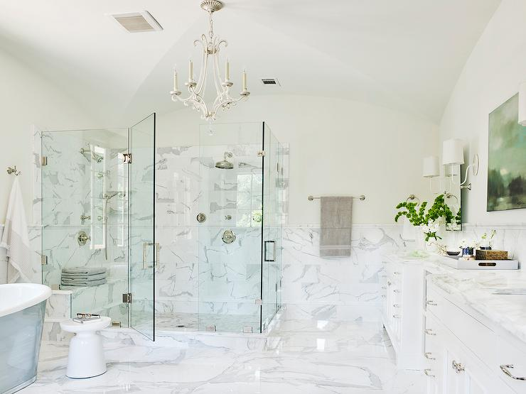 white master bathroom with oslo chandelier