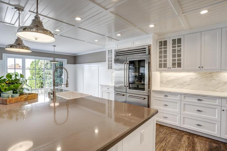 White Kitchen Island With Two Seeded Glass Pendants