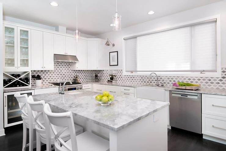White kitchen cabinets with super white quartzite for Best countertops for white cabinets