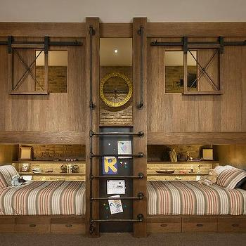 Rustic cottage boy's bunk room features wood plank built in bunk beds ...