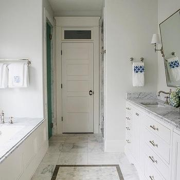 https://cdn.decorpad.com/photos/2015/09/11/m_long-narrow-master-bathroom-marble-tub-deck-rectangular-pivot-mirror.jpg
