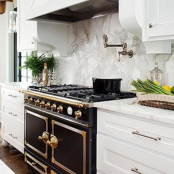 White Kitchen With Black French Stove Transitional Kitchen