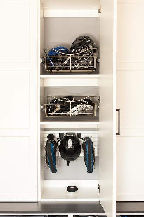 Love It Or List It   Fabulous Mudroom Features Closed Lockers Fitted With  Stacked Metal Pull Out Baskets Alongside A Mudroom Bench.