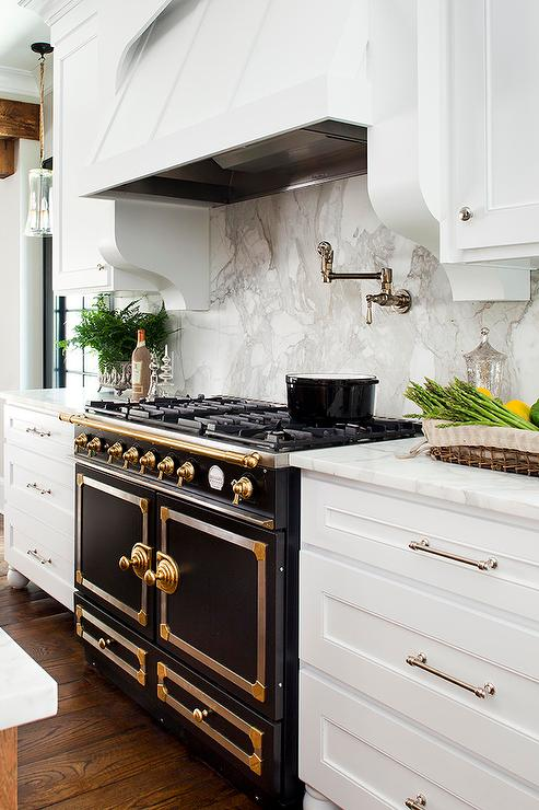 White Kitchen With Black French Stove