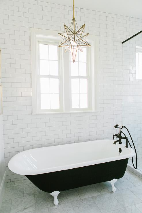 Stella glass star pendant black and white bathroom features walls lined with white subway tiles alongside a brass and glass star pendant pottery barn glass star pendant mozeypictures Image collections