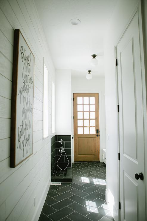 White And Gray Mudroom With Charcoal Gray Slate Tiles