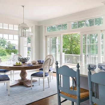 Round Dining Table With White Back Cane Chairs
