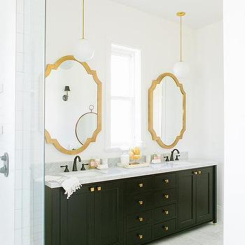 black bathroom vanity with gold mirror