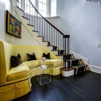 Yellow Sofa On Curved Staircase Wall