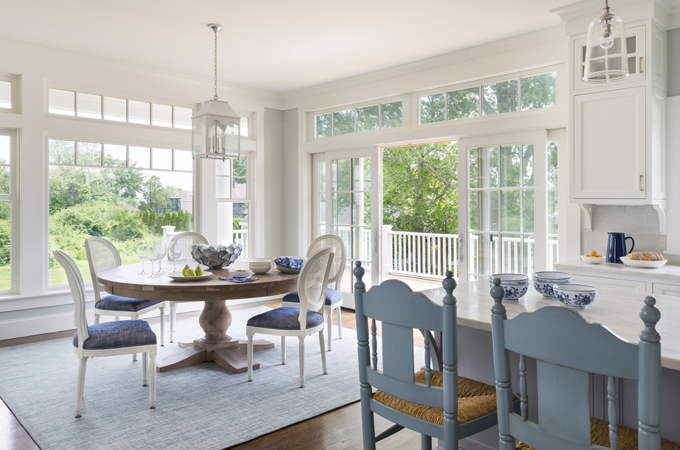 Eat In Kitchen Features A Restoration Hardware Round Salvaged Wood Trestle Dining  Table Lined With White Vintage French Round Cane Back Fabric Side Chairs ...
