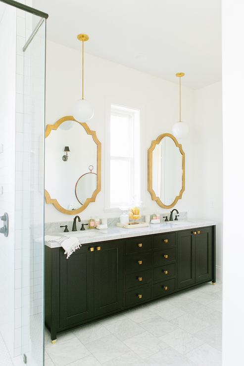 Black And Gold Bathroom Features A Black Dual Vanity Adorned With Gold  Square Knobs Topped With A Marble Countertop Fitted With His And Hers Sinks  And Oil ...
