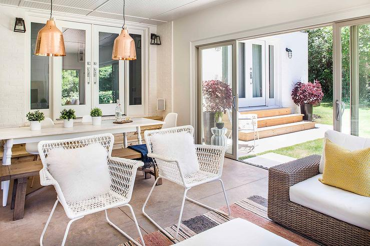 Sunroom Dining Space With Ikea Docksta Table And White Lattice