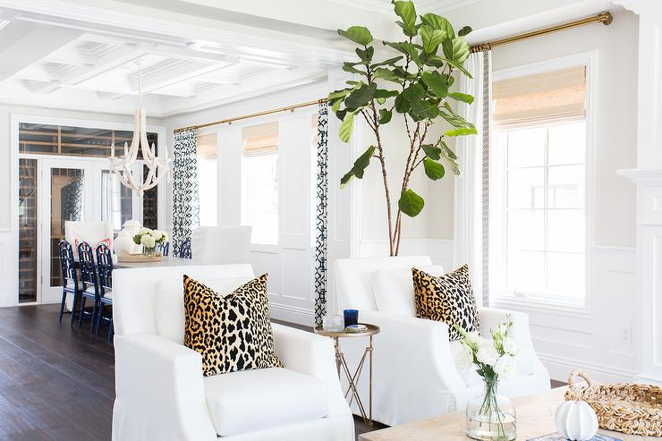 Beautiful Living Room Features A Pair Of White Chairs Lined With Arianna  Bell Leopard Pillows Flanking A Round Brass Directoire Table Facing A  Wisteria ...