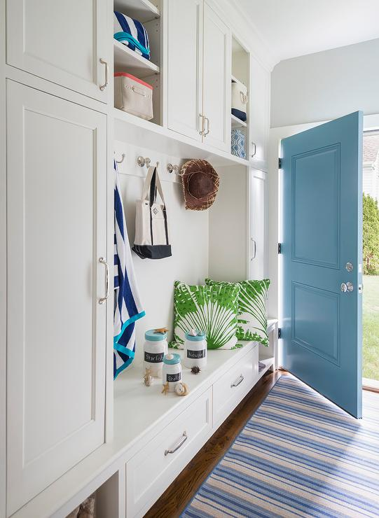 Mudroom with turquoise door cottage laundry room for Garderobe kleiner flur