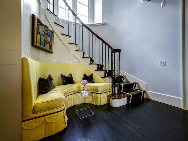 Yellow sofa on curved staircase wall transitional for Furniture for curved wall in foyer